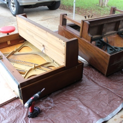 """Two pianos have been """"dropped"""" onto mattresses on the driveway so we can get the frames out."""