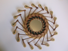 """""""Reverie"""" mirror surrounded by hammers"""