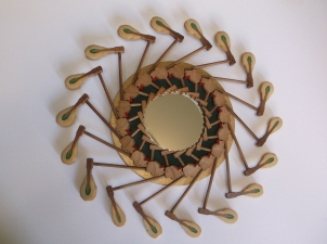 """Reverie"" mirror surrounded by hammers"