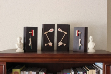 """""""Quartet"""" action pieces mounted to parts of a piano lid"""