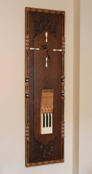 Maestro (Tiger Oak Clock) is bordered with 128 action pieces