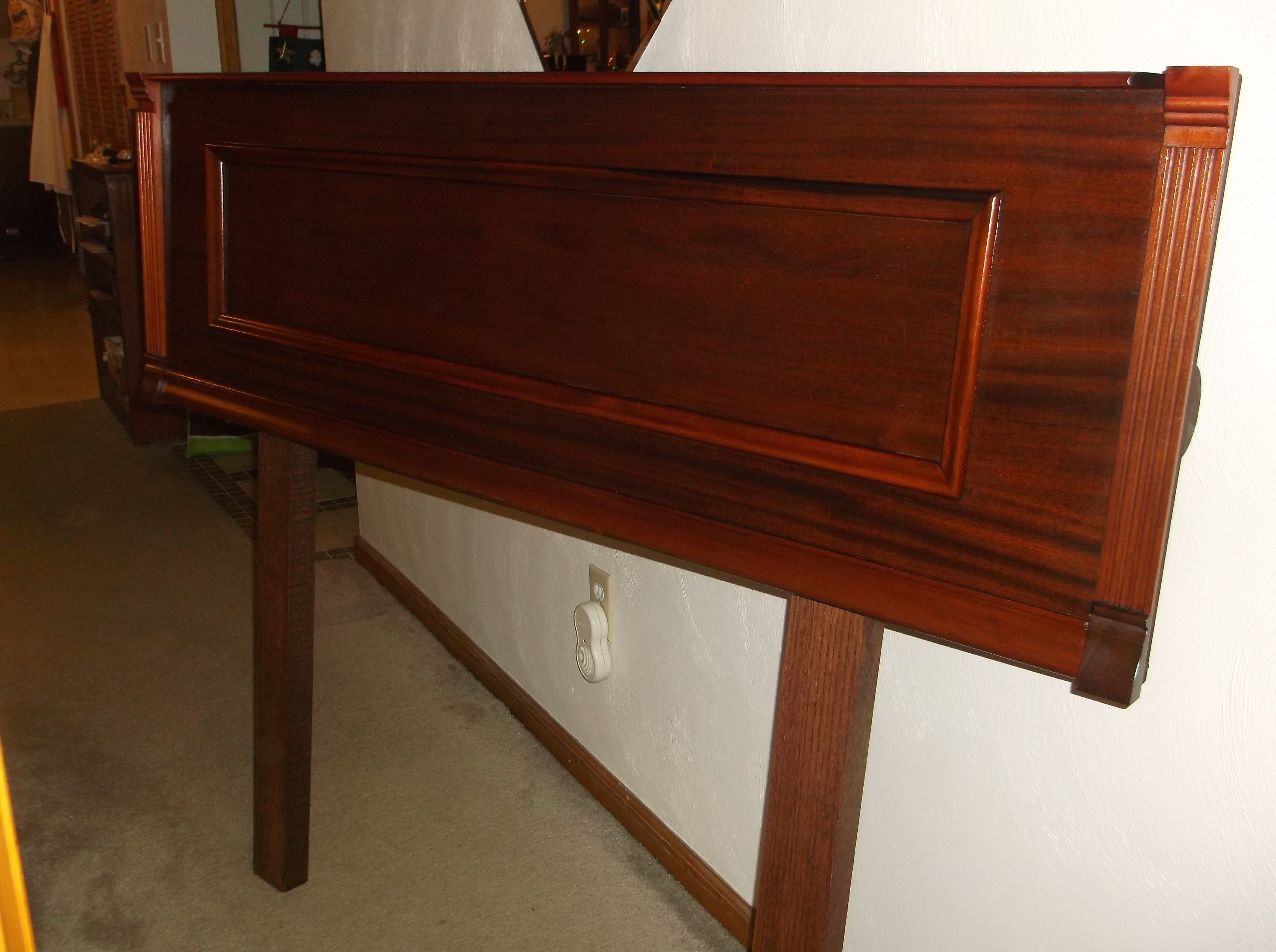 headboard made from an old piano