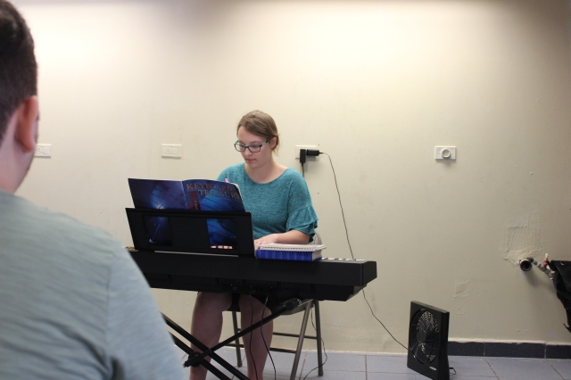 Young lady playing solo on keyboard