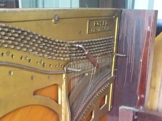 disassembling a Royal upright piano