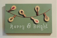Christmas sign made from piano parts